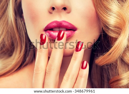 woman with red manicure .  girl with red nail Polish on the nails . Makeup and cosmetics - stock photo