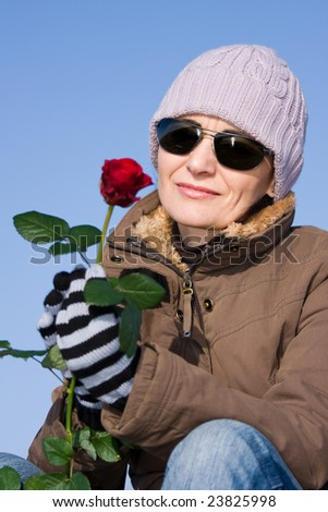 woman with red rose, small DoF