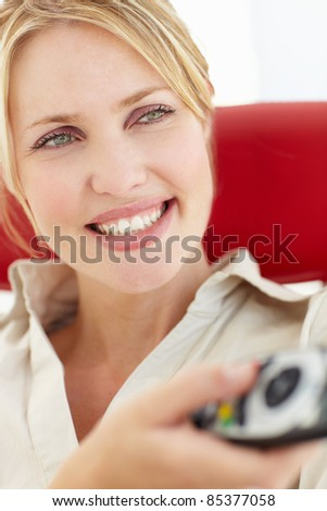 Woman with remote control - stock photo