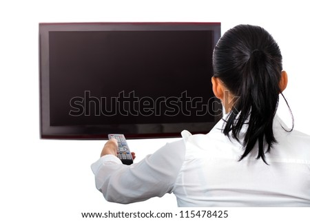 Woman with remote control watching TV - stock photo