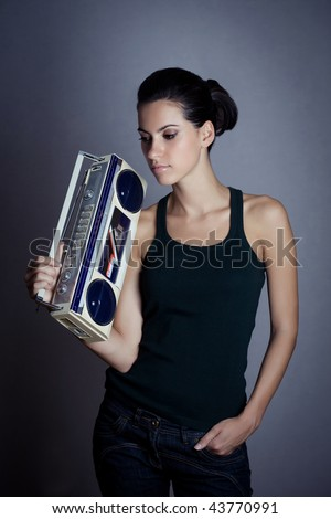 Woman with retro Boombox - stock photo
