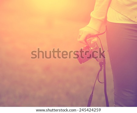 Woman with retro camera - stock photo