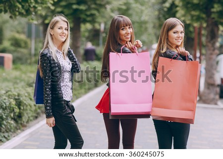 woman with returns from shopping with colored bags fashion