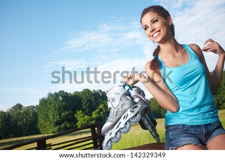 woman  with rollerblades in a park