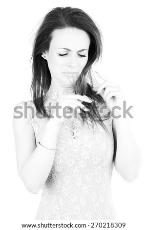 Woman with ruined split ends hair - stock photo