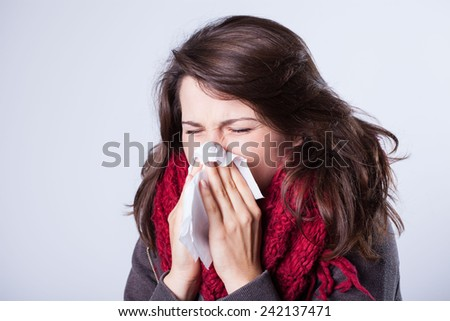 Woman with runny nose having autumn flu - stock photo