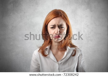 Woman with sad expression - stock photo