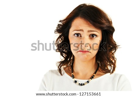 Woman with sad face over white background - stock photo