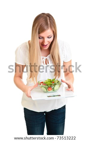 Woman with salad and scales isolated on white