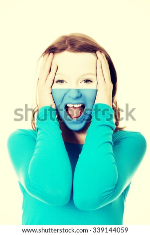 Woman with San Marino flag painted on face. - stock photo