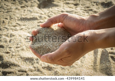 Woman with sand in hands