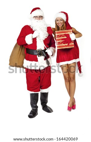 woman with santa claus holding a gift - stock photo