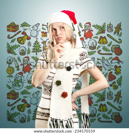 Woman with Santa's hat waiting for Christmas, make a wish, looking up - stock photo