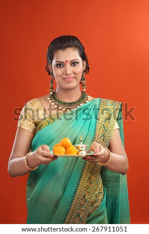 Woman with Sari and Offerings - stock photo