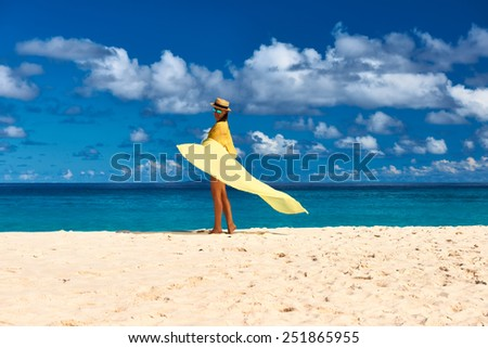 Woman with sarong at Seychelles beach - stock photo
