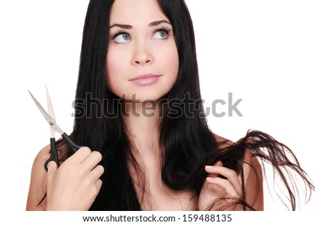 Woman with scissors, white background, copyspace - stock photo