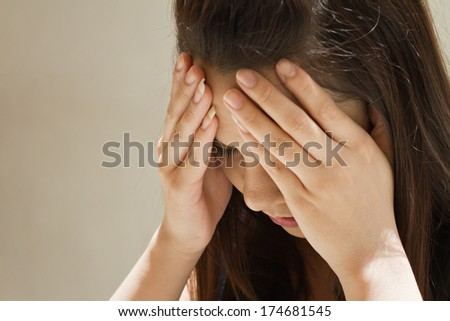 woman with serious headache, migraine, stress, hangover, mental problem