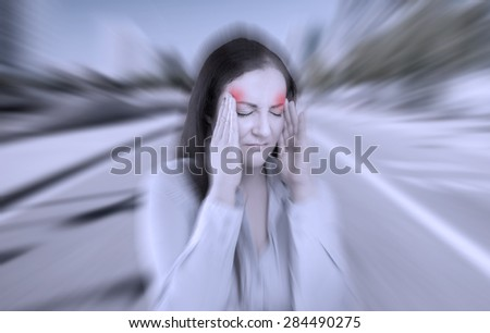 woman with severe headache with fraud in red zone - stock photo