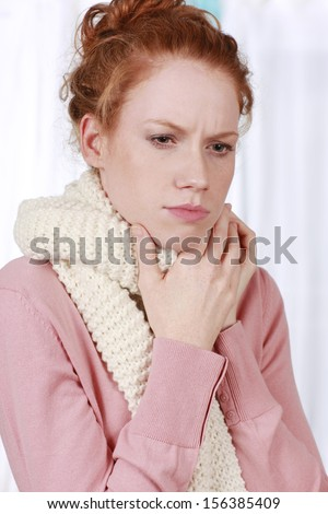 woman with shawl and sore throat - stock photo