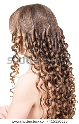 Woman with shiny brown curls isolated on a white background.