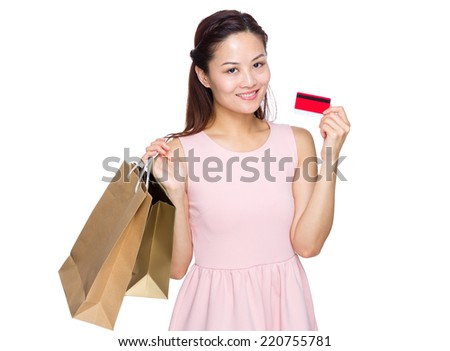 Woman with shopping bag and credit card