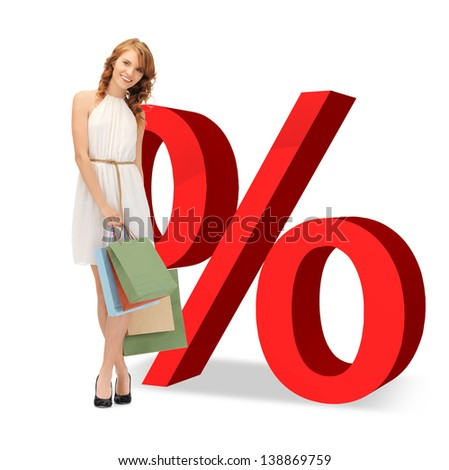 woman with shopping bags and big red percent sign - stock photo