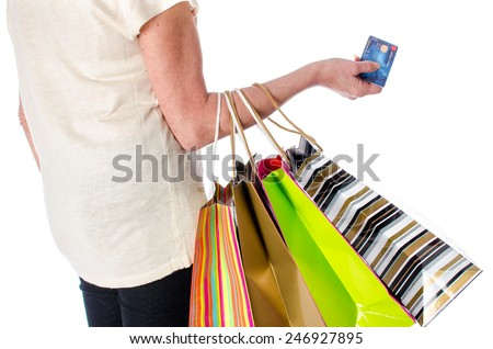 Woman with shopping bags and credit card, isolated on white