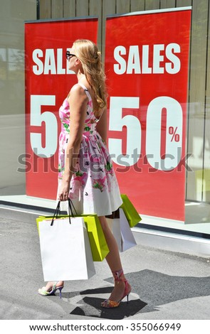 Woman with shopping bags at the sale - stock photo