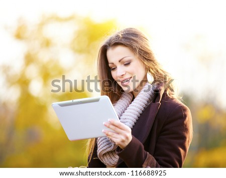 woman with shopping bags digital tablet outdoor