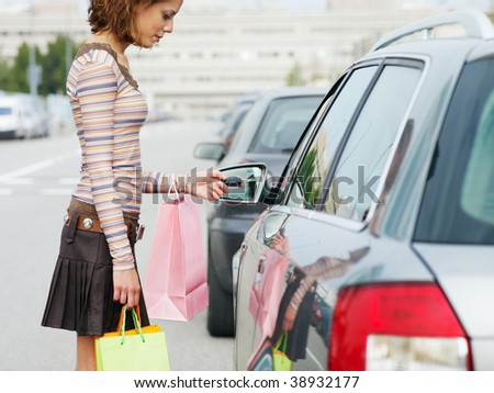 woman with shopping bags holding car keys