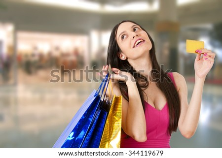 woman with shopping bags in mall - stock photo