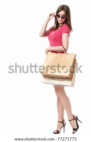 Woman with shopping bags in sunglasses on white background - stock photo