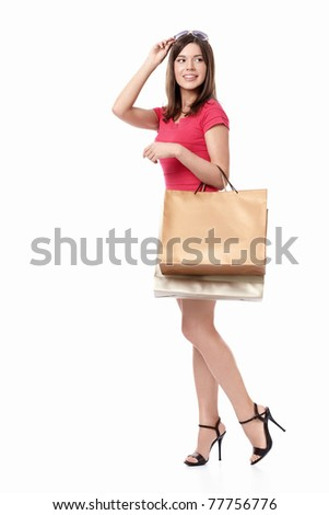 Woman with shopping bags on white background - stock photo