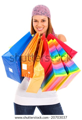woman with shopping bags smiling - isolated over a white background - stock photo