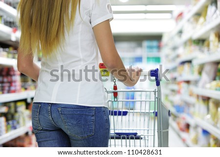 Woman with shopping cart, close up