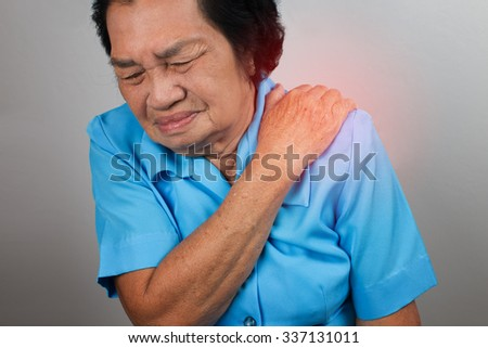 Woman with shoulder pain - stock photo
