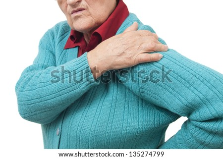 Woman with shoulder pain isolated on white background