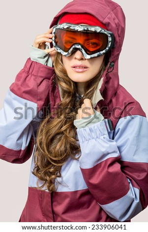 Woman with ski goggles isolated on light background
