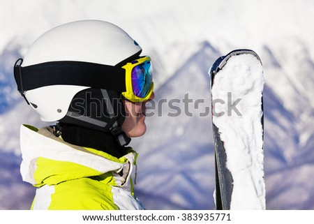 Woman with ski mask and helmet over snow mountain - stock photo