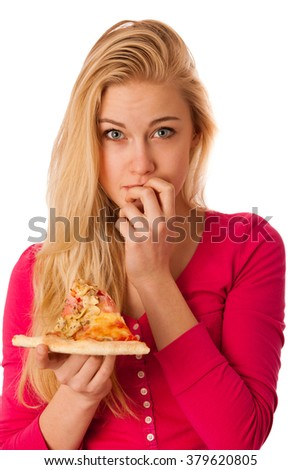 Woman with slice of delicious pizza, thinking about to break a promise of healthy eating. - stock photo