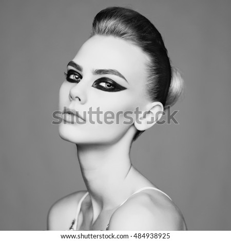 Woman with smoky-eyes makeup. Beautiful makeup with professional cosmetics. Art makeup with smoky-eyes. Fashionable cosmetic. Art portrait with beautiful makeup. Young sexy woman with art makeup.