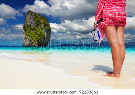 Woman with snorkel at the beach, Andaman Sea, Thailand - stock photo
