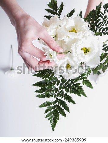 Woman with soft skin making a bouquet - stock photo
