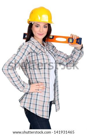 Woman with spirit-level - stock photo