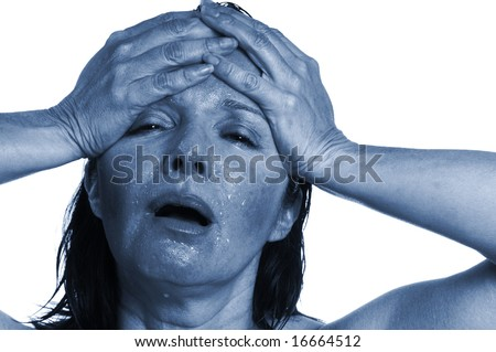 Woman with splitting headache blues - stock photo