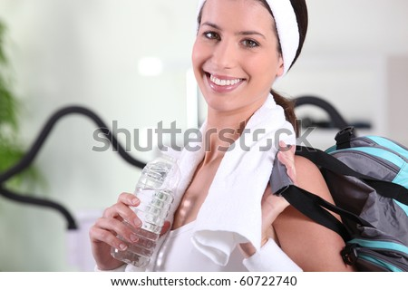 Woman with sports bag indoors