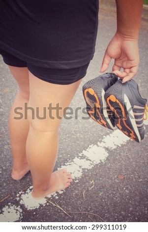 Woman with sports shoes