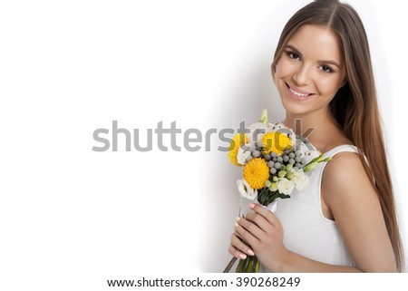Woman with Spring Flower bouquet  while standing against white background not isolated. Mother's Day. Springtime - stock photo