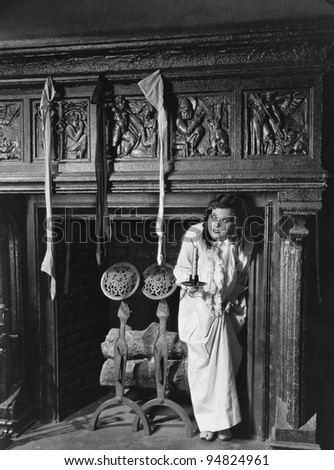 Woman with stockings hanging on hearth - stock photo