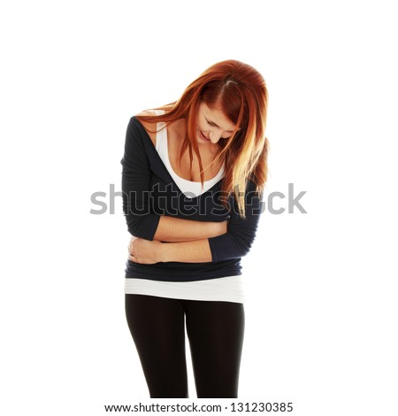 Woman with stomach issues,isolated on white - stock photo
